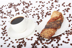 Coffee cup and cookies. Coffee and the sesame cookies on the table Stock Image