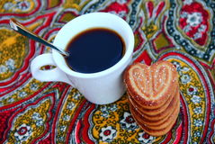Coffee. A cup of coffee with cookies Royalty Free Stock Images