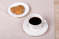 Coffee cup with cookies Stock Photos