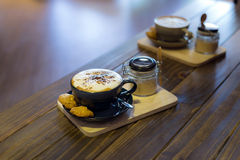 Coffee in cup and cookies Stock Images