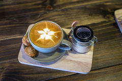Coffee in cup and cookies Royalty Free Stock Images