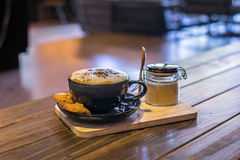 Coffee in cup and cookies. In coffee cafe stock photography