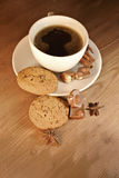 Coffee cup with cookies, chocolate and spices Royalty Free Stock Images