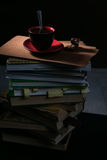 The coffee Cup and cookies and chocolate on stack of books stock photo