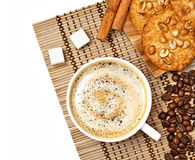 Coffee cup with cookies and cinnamon. On wooden tablecloth, studio shot, isolated on white, top view Stock Images