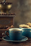 Coffee cup, cookies and coffee grinder Stock Photos