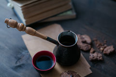Coffee Cup and cookies and coffee maker are on the wooden table next to the book stock photography