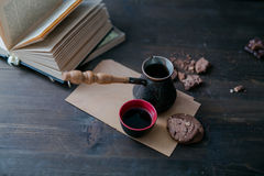 Coffee Cup and cookies and coffee maker are on the wooden table next to the book royalty free stock photo