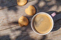 Coffee cup and cookies on garden table Royalty Free Stock Photography