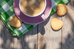 Coffee cup and cookies on garden table Stock Photography