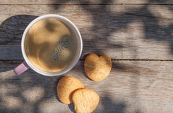 Coffee cup and cookies on garden table Stock Photos