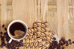 Coffee cup and cookies on old table Stock Photo