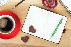 Coffee cup, cookies, red apple and office supplies Stock Images
