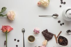 Coffee cup, cookies , roses , chokolate, coffee beens . flat lay stile. Modern minimalistic work place. White office desk table with laptop, coffee cup, book Stock Images