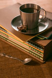 Coffee Cup with cookies is on the stack of notebooks royalty free stock images