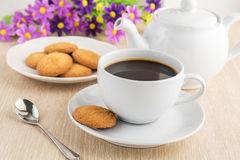 Coffee cup and cookies on table Stock Photography