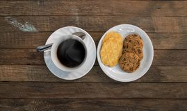 Coffee cup,cookies on wood Royalty Free Stock Photos