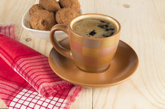 Coffee Cup and cookies on wooden table with red cloth Royalty Free Stock Image