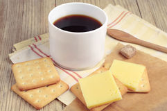 Coffee cup and cracker with cheese Royalty Free Stock Images