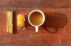 Coffee cup with cracker Stock Images