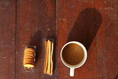 Coffee cup with cracker Stock Photo
