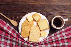 Coffee cup and crackers with cheese Stock Photos