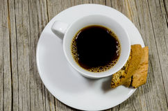 A coffee cup and crackers. On wooden background Royalty Free Stock Photo
