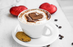 Coffee cup with cream and cocoa heart shape Royalty Free Stock Photography