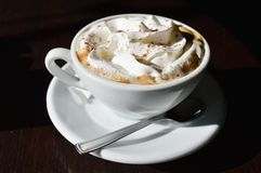 Coffee cup with cream Stock Photography