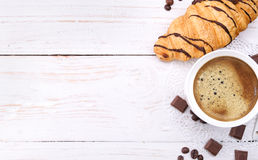 Coffee cup with a croissant . Stock Photography