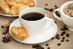 Coffee cup with croissant for breakfast.  Stock Images