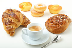 Coffee cup croissant cake and donuts Stock Image