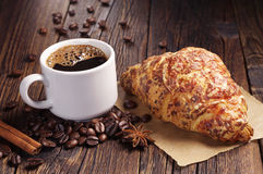 Coffee cup and croissant with cheese Royalty Free Stock Images