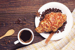 Coffee cup and croissant with cheese Stock Photography