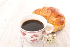 Coffee cup and croissant. Studio shot Royalty Free Stock Images