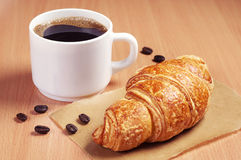 Coffee cup and croissant Royalty Free Stock Photo