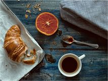 Breakfast table with croissant and coffee Stock Photos