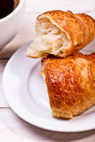 Coffee cup with a croissant Royalty Free Stock Photo