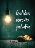 Coffee cup and croissant under light bulb lamp Royalty Free Stock Photography