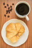 Coffee cup and croissant Royalty Free Stock Photos