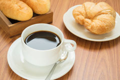 Coffee cup and croissant Stock Images