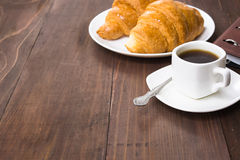 Coffee cup, croissants and notebook Royalty Free Stock Image