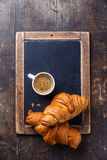 Coffee cup and croissants Royalty Free Stock Image