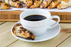 Coffee cup with croissants Stock Image