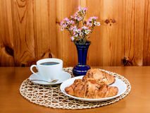 Coffee cup and croissants. On wooden table Stock Photos