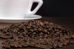 Coffee cup and crop. Coffee cup and coffee crop on a table, black background Stock Images