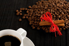 Coffee cup and crops on bamboo coaster Royalty Free Stock Image