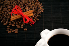 Coffee cup and crops on bamboo coaster Royalty Free Stock Photos