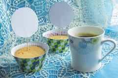Coffee Cup, cupcakes on a lace napkin, card with copy space stock photo