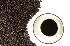 Coffee cup. With curved line brown coffee beans texture Stock Photos